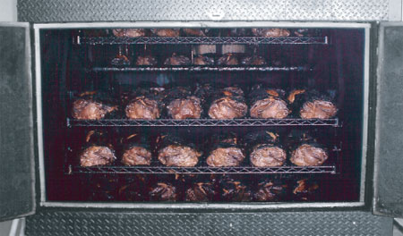 Smoker roasting pork butts